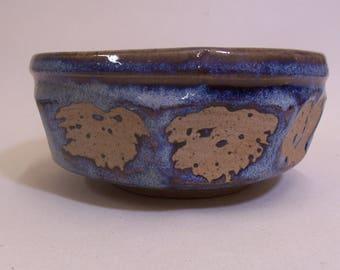 Tea bowl, (chawan). With blue beige glaze. Cut sides and wax resist decoration.