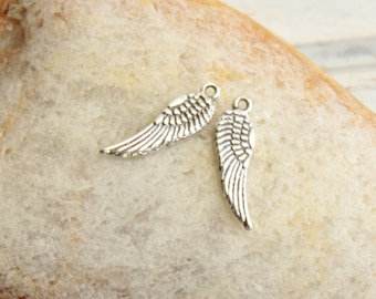 Two Tiny Angel Wing or Bird Wing Charms -- 2 Pieces... Sterling Silver Pendants