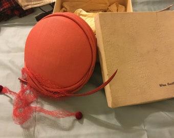 Red pillbox hat by Georgette, vintage