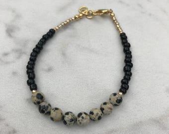 Black and gold single strand bracelet