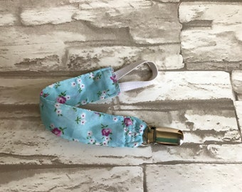 Pacifier clip, Toy tether