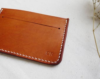 Leather card and money holder, money pouch.  Colour variations available.  Made in England
