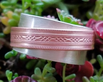 Sterling silver and copper band spinner ring