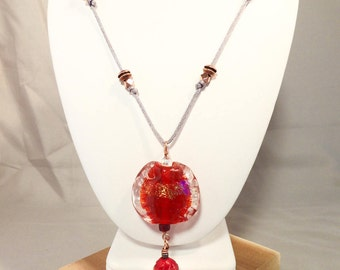 Artisan made glass bead pendant with shimmering red focal bead on gray satin cord