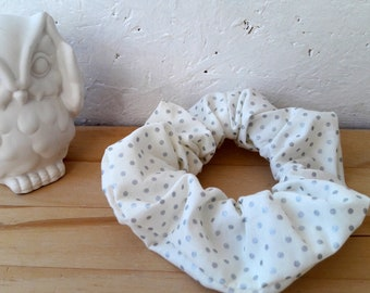 White fabric with small silver dots scrunchie