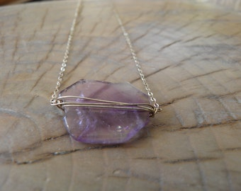 """Sterling Silver Necklace... """"Amethyst"""" beautiful amethyst stone wrapped in silver and hanging on sterling silver chain."""