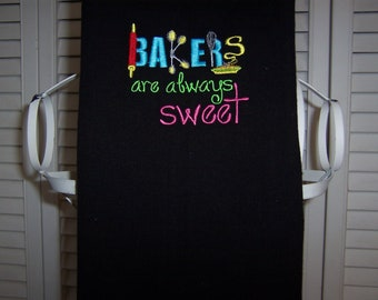 Black kitchen towel with machine embroidery baking quote