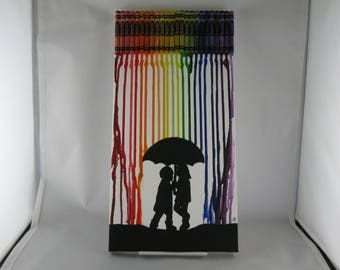 Rainbow Crayon Art with silhouette of a boy & girl under an umbrella