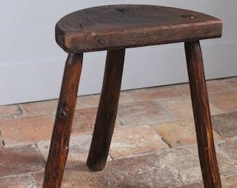 Old farm stool made of solid wood