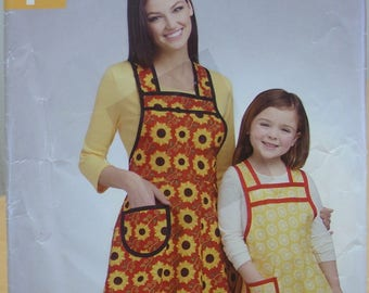 Simplicity 0758 or 1056 super simple apron sewing pattern for adult and child. All sizes.