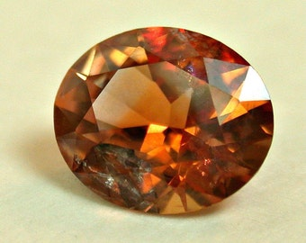 VINTAGE MONTANA Rock Creek SAPPHIRE Orange Faceted oval 0.85 cts src19