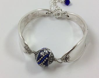 Burgundy 1934 silver spoon bracelet, blue bead, magnetic clasp, safety chain, size medium