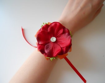 Red Hydrangea Petals Wrist Corsage with Orange and Rhinestone Accent