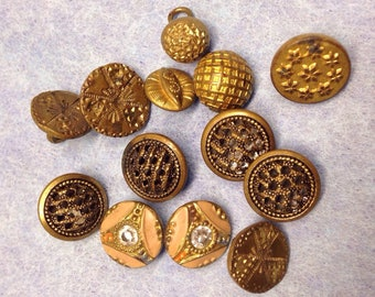 Antique brass diminutive buttons