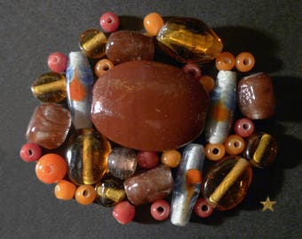 Made of Indonesian orange, Brown, amber glass beads