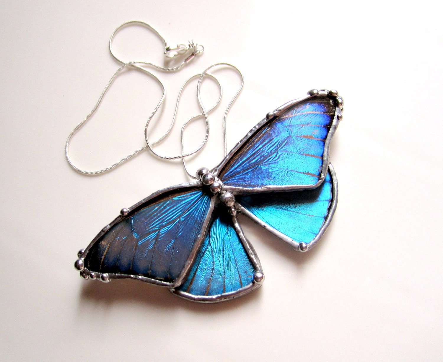 green necklace b white blue butterfly