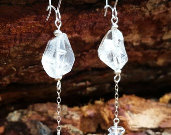 Chunky double terminated quartz with double terminated dangles on silver