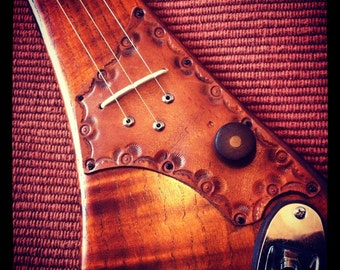Three string electric diddley bow by DaShtick guitars.