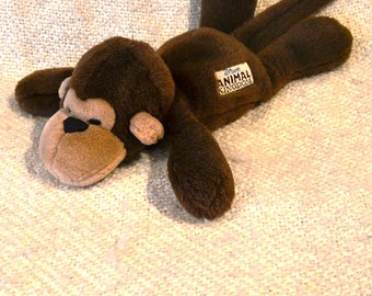 "DISNEY'S ANIMAL KINGDOM "" Monkey "" with Button in his ear that says ""Walt Disney World."" 18"" nose to tail. New Wot, owned not used."