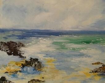 Seaside painting has oil knife