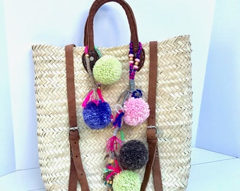 Straw backpack with pom poms