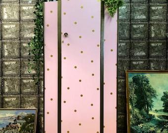 Pink and gold polka dot wardrobe