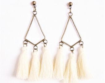 White tassel and chandelier earrings