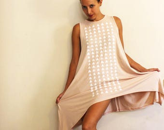 A pale pink dress with white triangles print