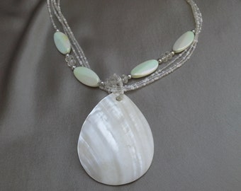 Chunky Natural Shell Necklace with Iridescent Glass Beads: Boho Chic in Three Strands of Treasures from the Sea