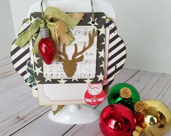 Handmade Christmas mini album in a stand