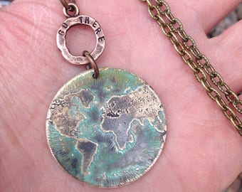 Etched metal world pendant necklace