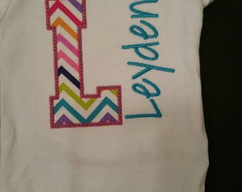 Bodysuit with Appliqued letter with childs name embroidered on the side