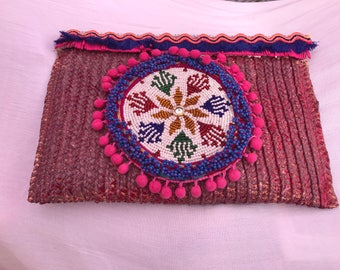 Purple centerpiece ethnic clutch.