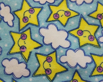 "Yellow stars and clouds on blue 100% cotton flannel  41""-44"" wide"