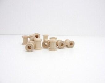 Miniature wooden spools 5/8 inch set of 12, wood spools