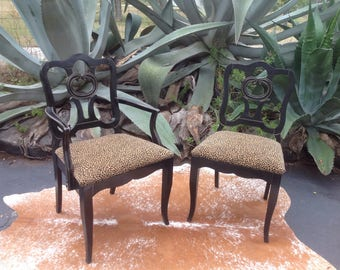 Black and gold captains chair with chenille animal print