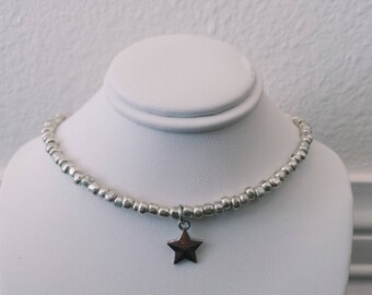 Silver choker with star In the center