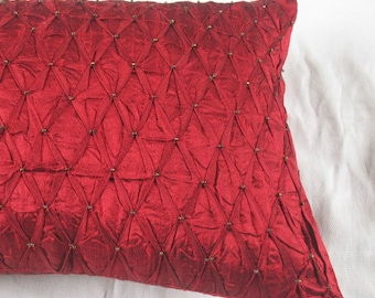 dark red silk oblong throw pillow with pintucks and bronze  beadwork.  Decorative pleated pillow cover. 12X22 inch custom made