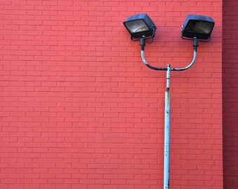 Streetlights Against Brick Wall
