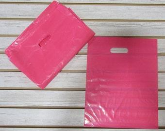 100 Pink Plastic Merchandise Bags (12 x 15 in.)