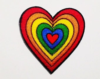 Rainbow heart embroidered iron on patch.