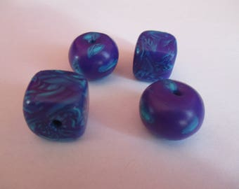 4 beads hand made polymer clay and varnished