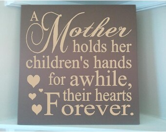 Personalized wooden sign w vinyl quote...A mother holds her children's hands for a while their hearts forever