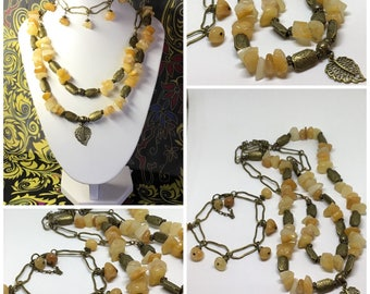 Luxurious yellow jade necklace with matching bracelet set.