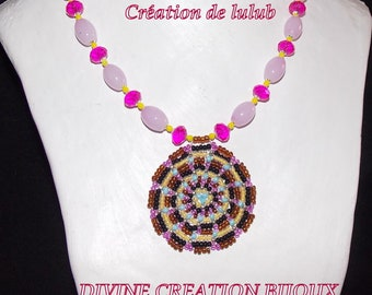 Spherical ornament style Mandala, and glass beads pink, fuschia and yellow.
