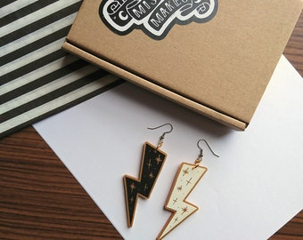 Mismatching Lightening Bolt Earrings by Misfit Makes. Black and White Statement Earrings. Geometric Dangle Earrings. Acrylic Jewellery