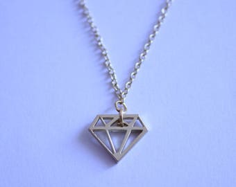 gold chain necklace and a diamond