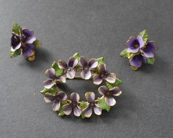 Painted enamel violets brooch and clip on earrings set