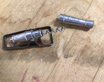 Corkscrew in the form of a cannon. Also trigger for beer bottles