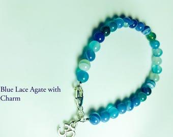 Blauer Achatarmband, blaue Spitze Achat und Om Anhänger Ohrringe